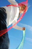 Child ribbons and sky Royalty Free Stock Photos