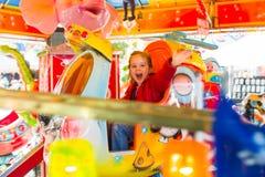 Child rides on kirtag in ringelspöiel Stock Image