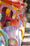 Child rides in the summer attraction in the park. Stock Image