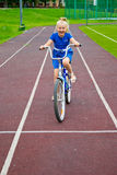 Child riding a bicycle Stock Photos