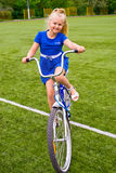 Child riding a bicycle Royalty Free Stock Images
