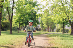 The child riding a bicycle Stock Photos