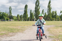 The child riding a bicycle stock photography