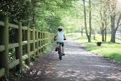 Boy riding his bike stock photography