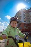 Child riding a bike Stock Images