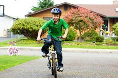 Child riding a bike royalty free stock image