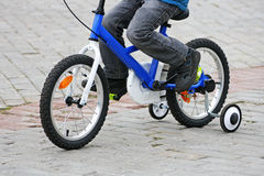 The child riding on the bike. Stock Images