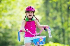 Child riding bike. Kid on bicycle. Stock Photos