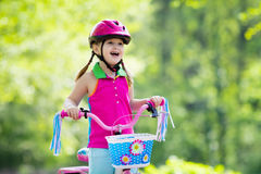 Child riding bike. Kid on bicycle. Royalty Free Stock Photography