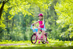 Child riding bike. Kid on bicycle. Stock Image