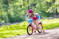 Child riding bike. Kid on bicycle. Royalty Free Stock Image