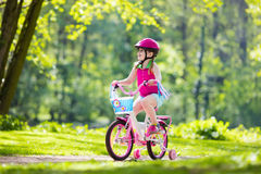 Child riding bike. Kid on bicycle. Stock Photo