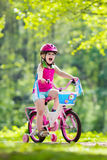 Child riding bike. Kid on bicycle. Stock Images