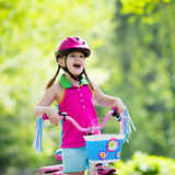 Child riding bike. Kid on bicycle. Royalty Free Stock Images