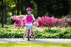 Child riding bike. Kid on bicycle. Stock Photography