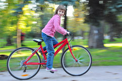 Child riding  bike in park Stock Images