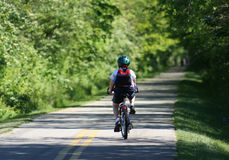 Child Riding on Bike Path. A Young Child exercising on the bike path Royalty Free Stock Images