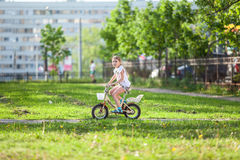 Child riding bike in summer day Royalty Free Stock Photo