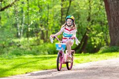 Child on bike. Kids ride bicycle. Girl cycling. royalty free stock image
