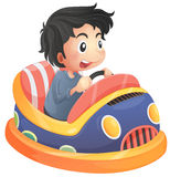 A child riding in a bumpcar Royalty Free Stock Images