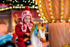 Child riding carousel on Christmas market Royalty Free Stock Images