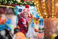 Child riding carousel on Christmas market Royalty Free Stock Image
