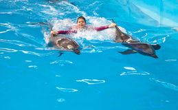 Child riding on dolphins Royalty Free Stock Photos