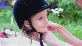 Child with a riding helmet stock video