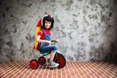 Child riding a retro bicycle Stock Photo