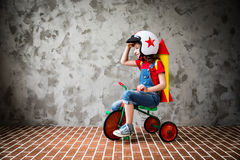 Child riding a retro bicycle Stock Photos