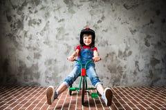 Child riding on retro bicycle Royalty Free Stock Image
