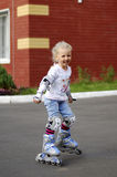A child riding on the rollers Stock Images