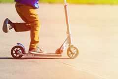 Child riding scooter, active sport kids Royalty Free Stock Photo