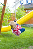 child riding a swing Stock Photo