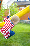 Child riding a swing Royalty Free Stock Photography