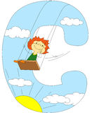 Child riding on a swing. Letter Stock Images