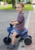 Child riding toy bike Stock Photography