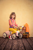 Child riding toy car Stock Photos