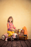 Child riding toy car Royalty Free Stock Photo