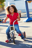 Child Riding Tricycle In Playground Stock Photo