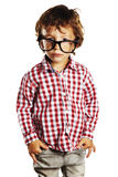 Child with rimmed glasses and hands in pockets Stock Images