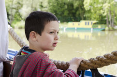 Child on river boat Stock Image