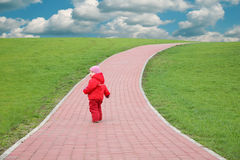 Child on the road Stock Image