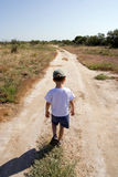Child on the road Royalty Free Stock Images