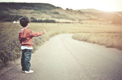 Child on the road. Child alone on the road Stock Images