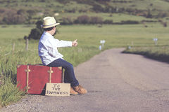 Child on the road. Child suitcase on the road Royalty Free Stock Photography