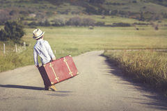 Child on the road. With a suitcase Stock Image