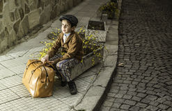 Child on a road with vintage bag Royalty Free Stock Photo