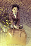 Child on a road with vintage bag Stock Photography
