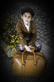 Child on a road with vintage bag Royalty Free Stock Images